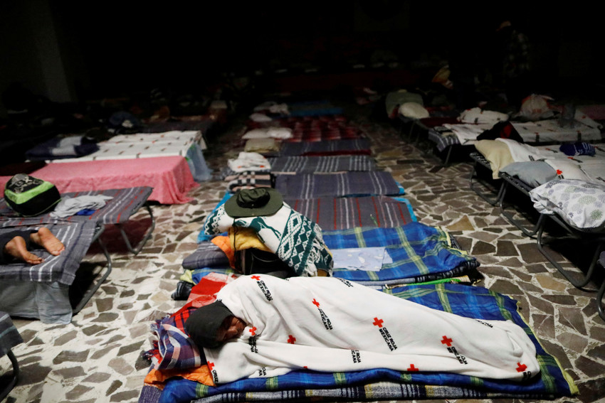 A Central American migrant rests April 7 at a temporary shelter inside a Catholic church in Puebla, Mexico.