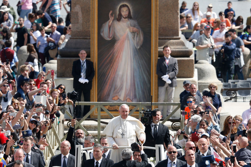 Pope Francis greets the crowd after celebrating Mass marking the feast of Divine Mercy in St. Peter's Square at the Vatican April 8.