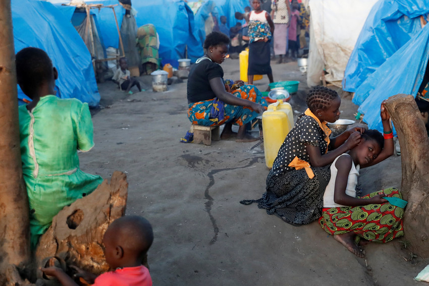 Displaced people sit outside their makeshift shelters April 9 at a camp in Bunia, Congo. Civilians in eastern Congo have been brutalized by militias, rebels and military units.