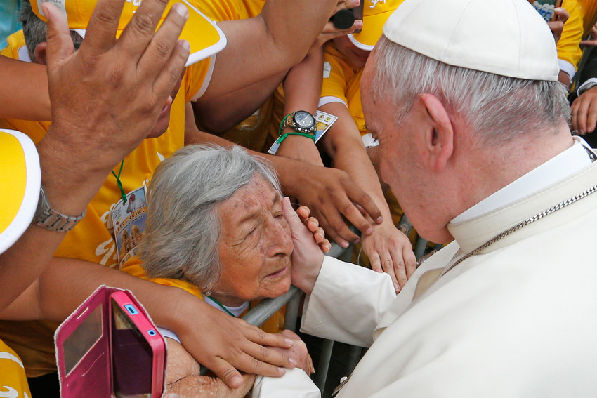 """Pope Francis greets a blind woman who is 99 years old along the parade route in Trujillo, Peru, Jan. 20. At the end of their plenary meeting March 6-9 at the Vatican, members of the Pontifical Commission for Latin America proposed that the Church hold a Synod of Bishops """"on the theme of the woman in the life and mission of the Church."""""""