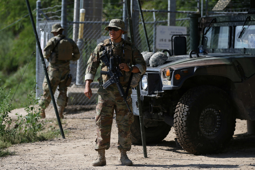 Members of the Texas National Guard watch the U.S.-Mexico border April 11 from an outpost along the Rio Grande in Roma, Texas
