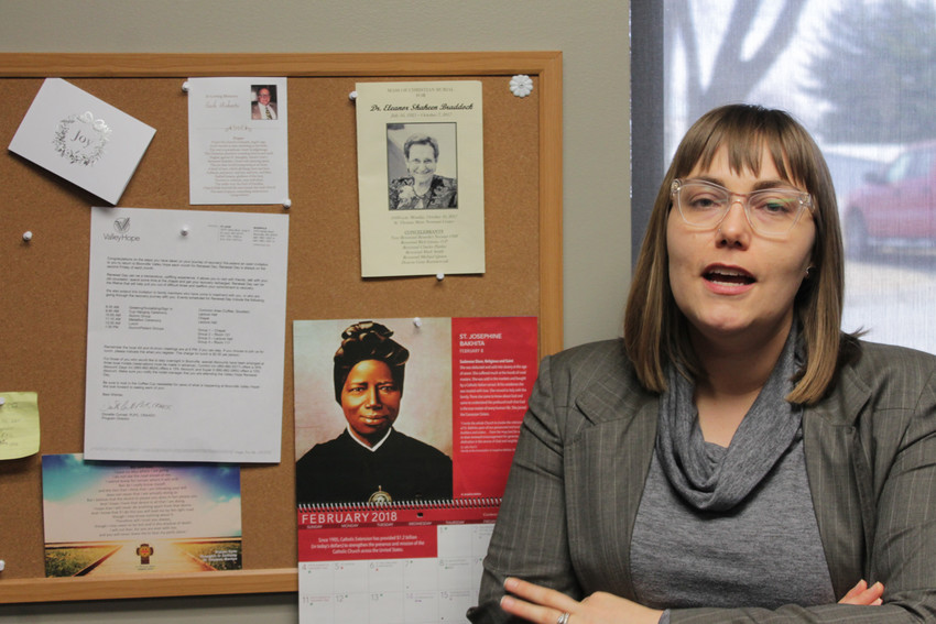 "Heather Morgan, a chaplain at Valley Hope of Boonville, an inpatient treatment center for people with addictions, explains the significance of the items on her ""hall of fame"" bulletin board in her office."