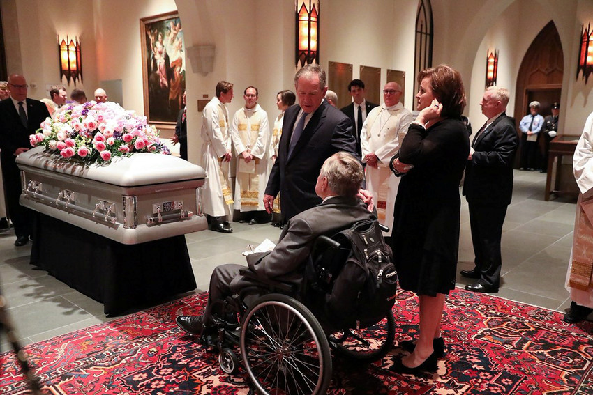 Former President George W. Bush is seen with his father George H.W. Bush after funeral services for former first lady Barbara Bush at St. Martin's Episcopal Church in Houston, Texas, April 21.