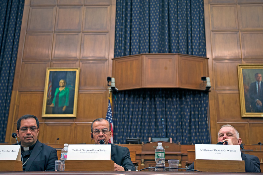Cardinal Gregorio Rosa Chavez and Archbishop Jose Luis Escobar Alas, both of El Salvador, and Miami Archbishop Thomas G. Wenski participate in a discussion about El Salvador's root causes of poverty, violence and migration at the Rayburn House Office Building in Washington April 13.