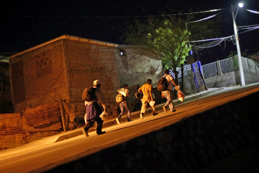 """Central American migrants move along a street in Hermosillo, Mexico, April 23. Newark's Cardinal Joseph W. Tobin said in April 23 podcast by New York's Center for Migration Studies that he's worried that reducing the number of immigrants, particularly refugees to the United States, and demonizing them represents a """"hardening of the American heart."""""""