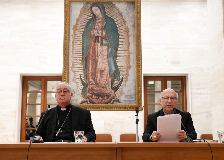 Bishop Juan Ignacio Gonzalez Errazuriz of San Bernardo, Chile, and Auxiliary Bishop Fernando Ramos Perez of Santiago, Chile, attend a press conference in Rome May 18. Bishop Gonzalez said every bishop in Chile offered his resignation to Pope Francis after a three-day meeting with him at the Vatican.
