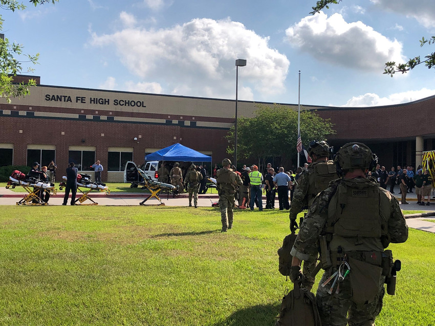 "Law enforcement responds to a mass shooting May 18 at Santa Fe High School in Santa Fe, Texas, near Houston. Police reported that at least eight people were dead and several others were injured. Assistant Principal Cris Richardson told reporters the shooter was ""arrested and secured"" but offered no other details about the person's identity or motive."