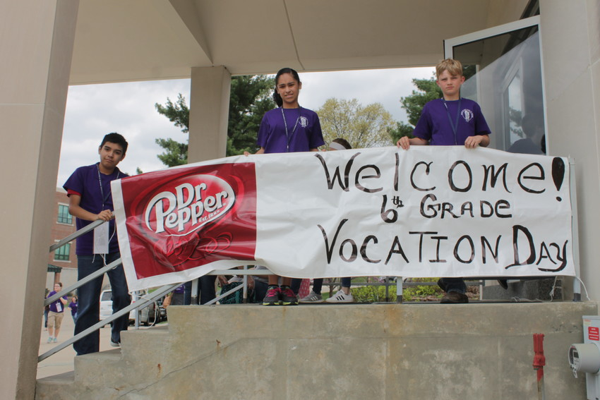 Participants in this year's diocesan Sixth Grade Vocation Day at the Cathedral of St. Joseph and neighboring St. Joseph Cathedral School hold up the welcome banner during lunch. The event drew about 625 sixth-graders from schools and families all over the diocese, along with their chaperones.