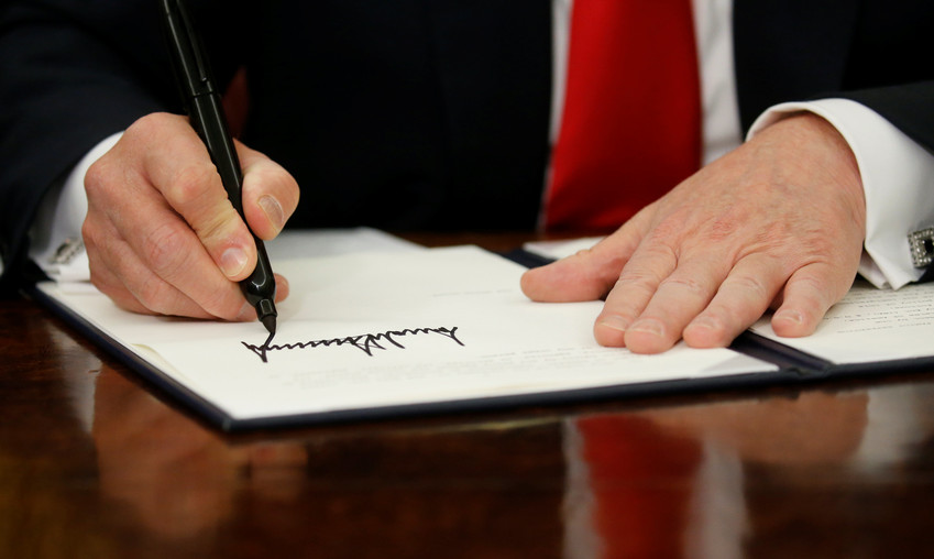 President Donald Trump signs an executive order June 20 to halt the separation of families.