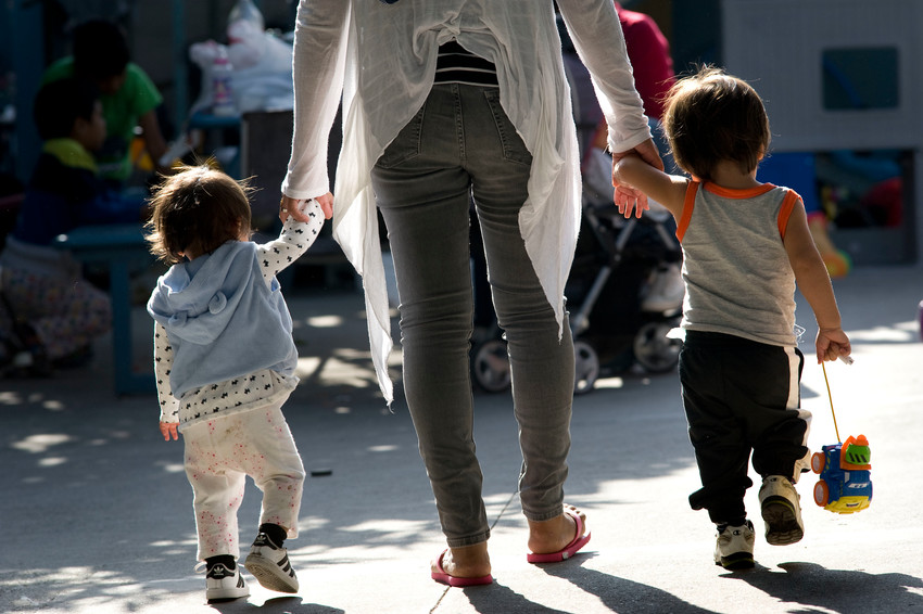 A woman walks with children at a shelter for migrant women and children in Tijuana, Mexico, June 20. The shelter is run by the sisters of the Missionaries of St. Charles Borromeo and has about 80 people who intend to seek asylum in the United States.