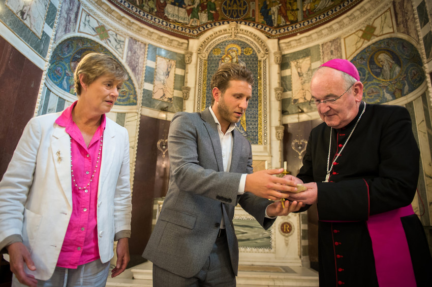 Sophie Andreae, James Rubin and Archbishop George Stack present St. Clement I bone relics at Westminster Cathedral in England June 19.