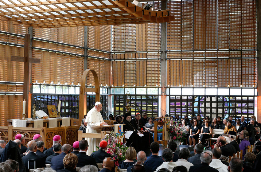 Pope Francis speaks as he attends an ecumenical prayer service at the World Council of Churches' ecumenical center in Geneva June 21.