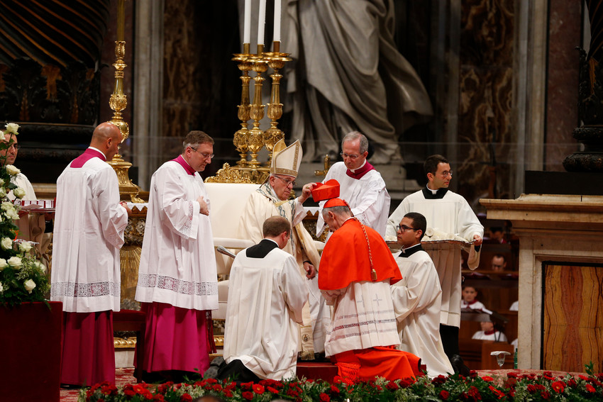 New Cardinal Luis Ladaria, prefect of the Congregation for the Doctrine of the Faith, receives his red biretta from Pope Francis during a consistory to create 14 new cardinals in St. Peter's Basilica at the Vatican June 28.