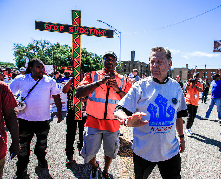 "Father Michael Pfleger, pastor of St. Sabina Parish in Chicago, leads the ""Dan Ryan Shut Down"" protest July 7 in Chicago. Fr. Pfleger and hundreds of anti-gun activists filled a major Chicago highway for about an hour demanding that city officials do something to stop gun violence in the city."