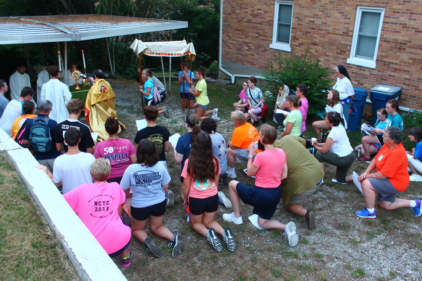 Teens, mentors and leaders of the 2018 CHRISTpower retreat take part in an outdoor Eucharistic procession the evening of Friday, July 13.