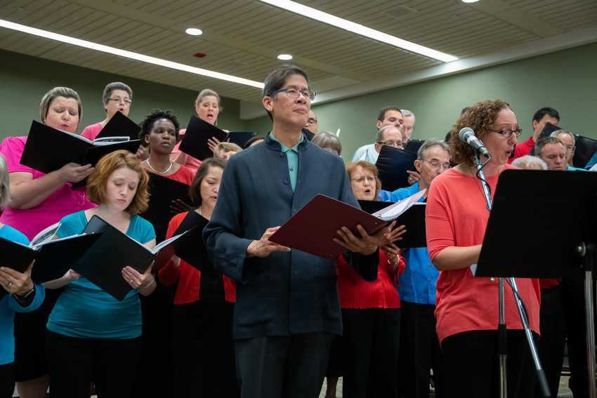 Paulist Father Ricky Manalo rehearses with a combined choir from the Baltimore and Washington archdioceses July 12 during the National Association of Pastoral Musicians convention in Baltimore July 12. The association named the priest Pastoral Musician of the Year.