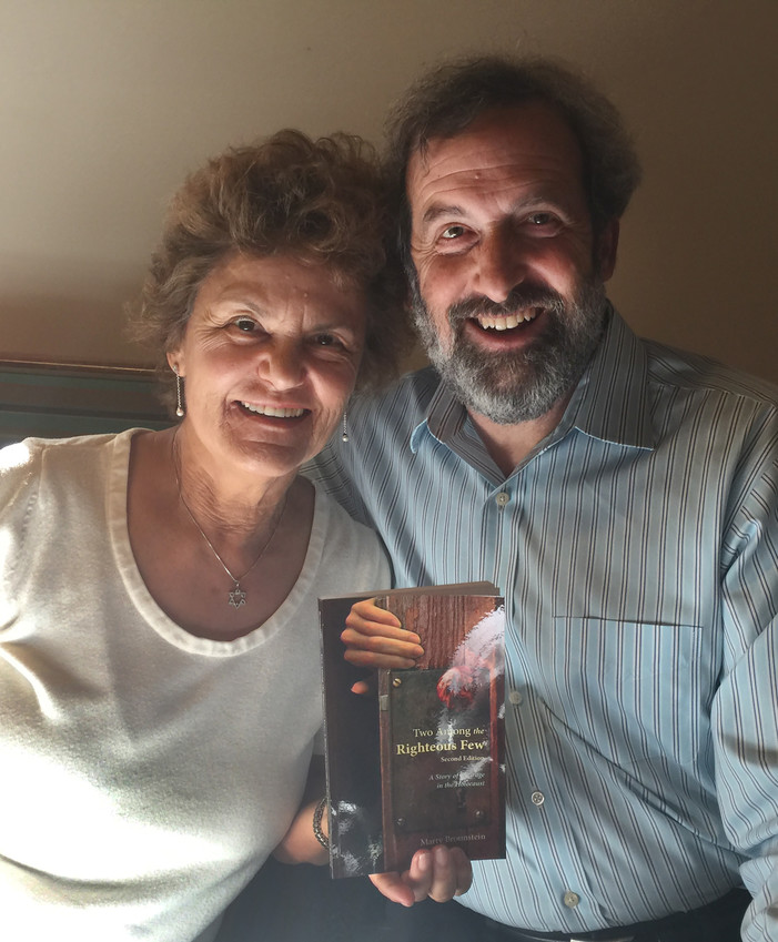 """Marty Brounstein, author of """"Two Among the Righteous Few: A Story of Courage in the Holocaust,"""" poses in early April with his wife, Leah Baars."""