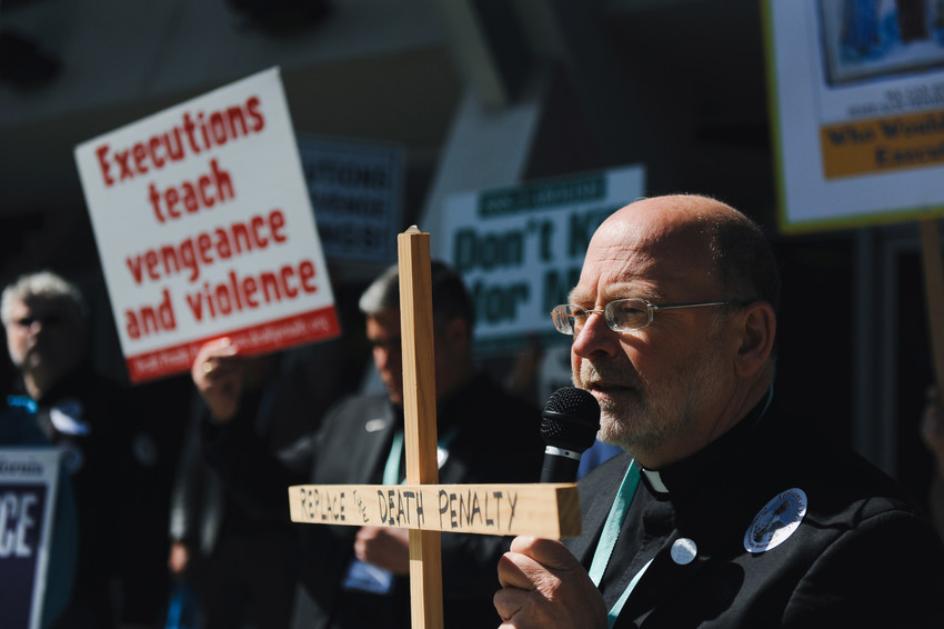 Father Chris Ponnet, chaplain at the St. Camillus Center for Spiritual Care in Los Angeles, speaks during a rally protesting the death penalty in Anaheim, Calif., Feb. 25, 2017. Pope Francis has ordered a revision to the Catechism to state that the death penalty is inadmissible and he committed the Church to its abolition.
