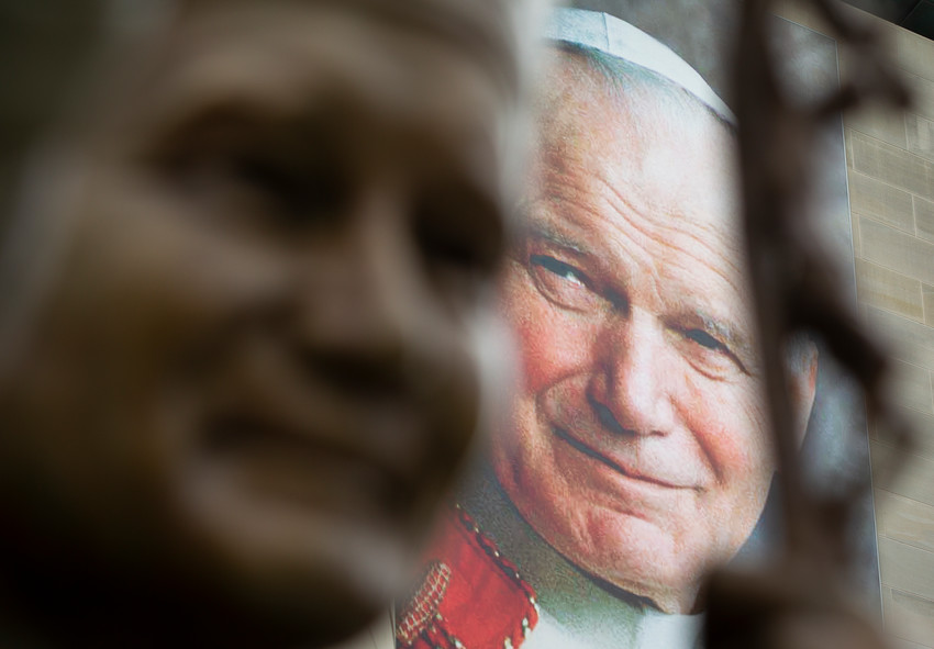 A banner of St. John Paul II is seen behind his sculpture May 16 at the St. John Paul II National Shrine in Washington.