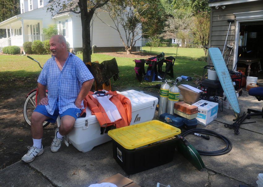 Gary Johnson sits outside his home in Trent Woods, North Carolina, Sept. 22. The house was flooded during Hurricane Florence, and Johnson, his wife, Megan, and their two daughters are unable to live in it.