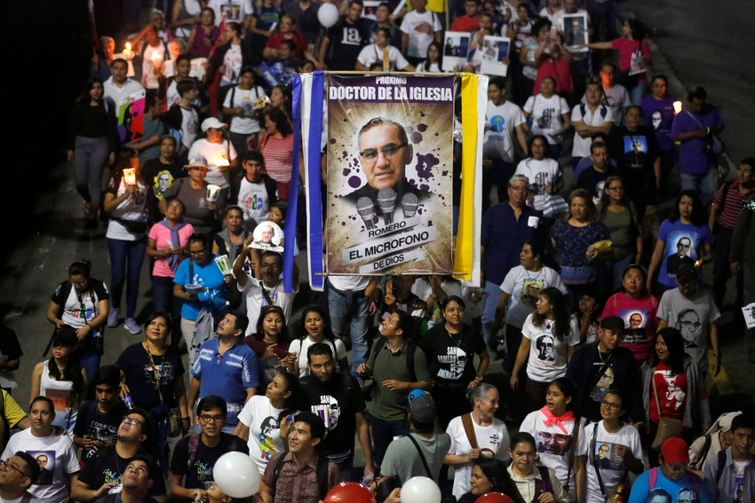 People carry a banner of St. Oscar Romero during an Oct. 13 procession in San Salvador, El Salvador. Pope Francis celebrated the canonization Mass for St. Oscar Romero and six other new saints in St. Peter's Square Oct. 14 at the Vatican.