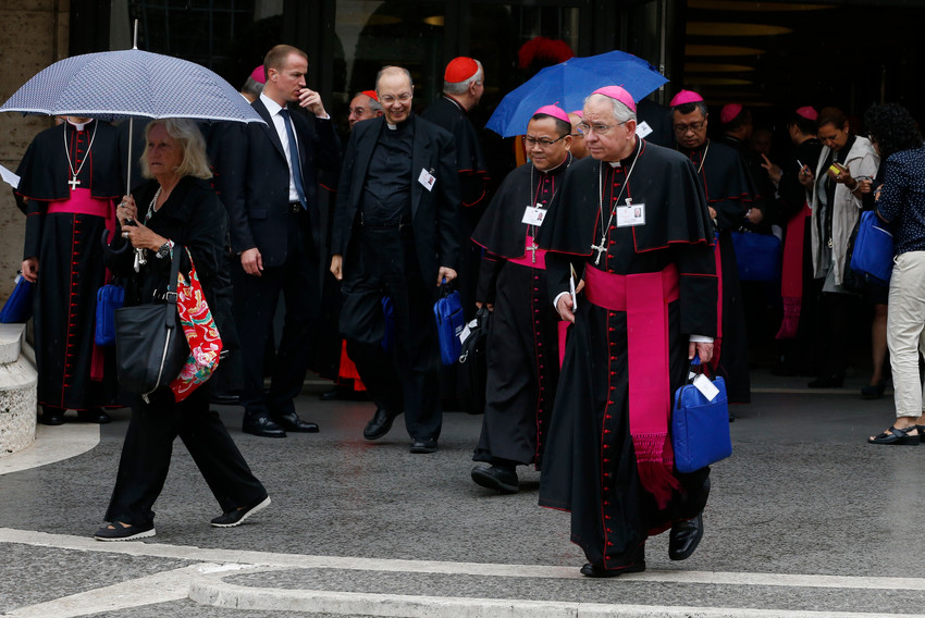 Archbishop Jose H. Gomez of Los Angeles, vice president of the conference, leaves a session of the Synod of Bishops on young people, the faith and vocational discernment at the Vatican Oct. 11. In his speech at the synod Archbishop Gomez called for Church leaders to model holiness by living the Gospel they preach.