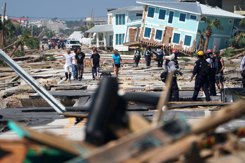 First responders and residents walk amid debris and destroyed homes Oct. 11 after Hurricane Michael swept through Mexico Beach, Fla. The Category 4 storm raged through the Florida Panhandle into Georgia Oct. 10 as the most powerful storm to hit the continental United States in decades, turning homes into piles of lumber and flooding subdivisions.