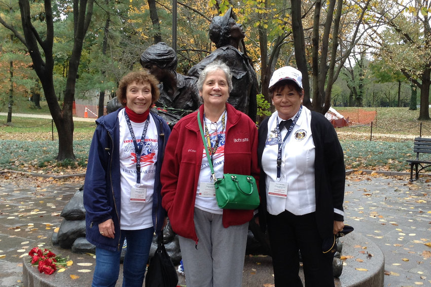 Marilyn Bassett (left), a U.S. Air Force veteran of the Vietnam War and principal of Visitation Inter-Parish School in Vienna, and two other veterans stand by the Nurses Memorial in Arlington National Cemetery during a Central Missouri Honor Flight to Washington, D.C. They were the only women in the group of 108.