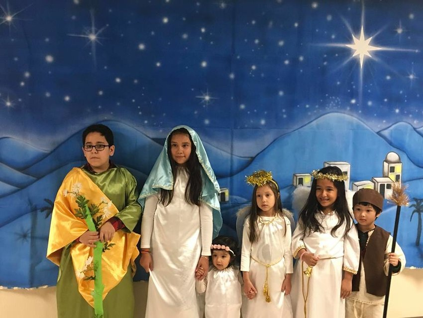 Children take part in the 2017 Las Posadas celebration at St. Peter Church in Jefferson City. This traditional Advent devotion is a reenactment of the Holy Family's frantic search for shelter in Bethlehem so Mary could have her baby, Jesus.