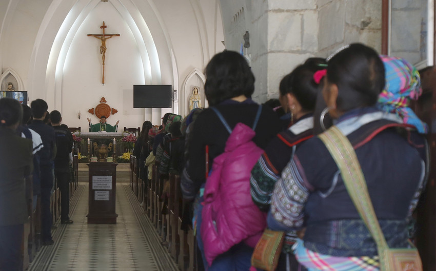 "A priest celebrates Mass in 2015 at a Church attended by ethnic Hmong Catholics in the village of Sapa, Vietnam. Delegations from the Vatican and from Vietnam reported continued progress in their discussions, including agreeing on ""upgrading"" relations with a permanent papal representative ""in the near future,"" a Vatican press statement said."