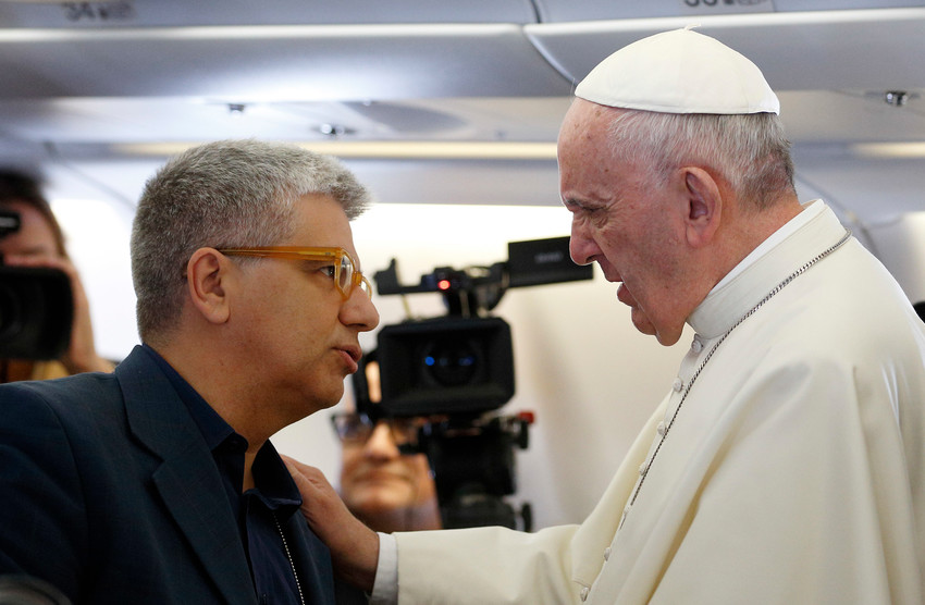 """Pope Francis speaks with Italian journalist Andrea Tornielli aboard his flight from Rome to Havana in this Sept. 19, 2015, file photo. The Vatican announced Dec. 18 that the Pope made new appointments to the Dicastery for Communication, naming Tornielli, an Italian journalist, as its """"editorial director."""""""