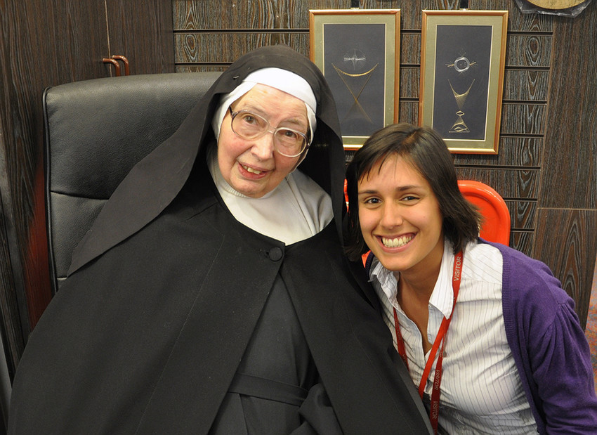 In this 2011 file photo, Sister Wendy Beckett poses with an unidentified admirer during a book signing at St. Pauls Bookshop in London.