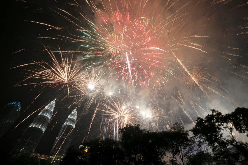New Year's fireworks explode Jan. 1 near Petronas Twin Towers in Kuala Lumpur, Malaysia.