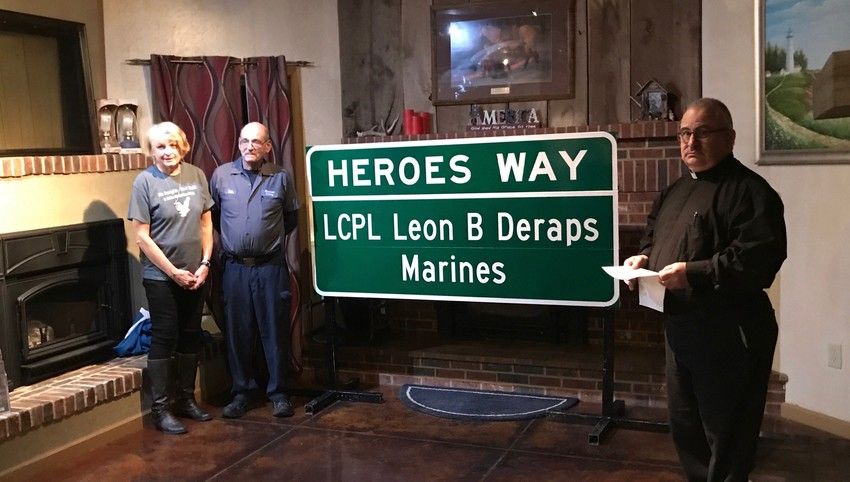 Sandra and Dale Deraps and Father Anthony Rinaldo help dedicate one of the signs that are now posted near the Missouri River bridge at Rocheport on Interstate 70, in memory of Marine L.Cpl. Leon Deraps, who was killed in Iraq in 2006.