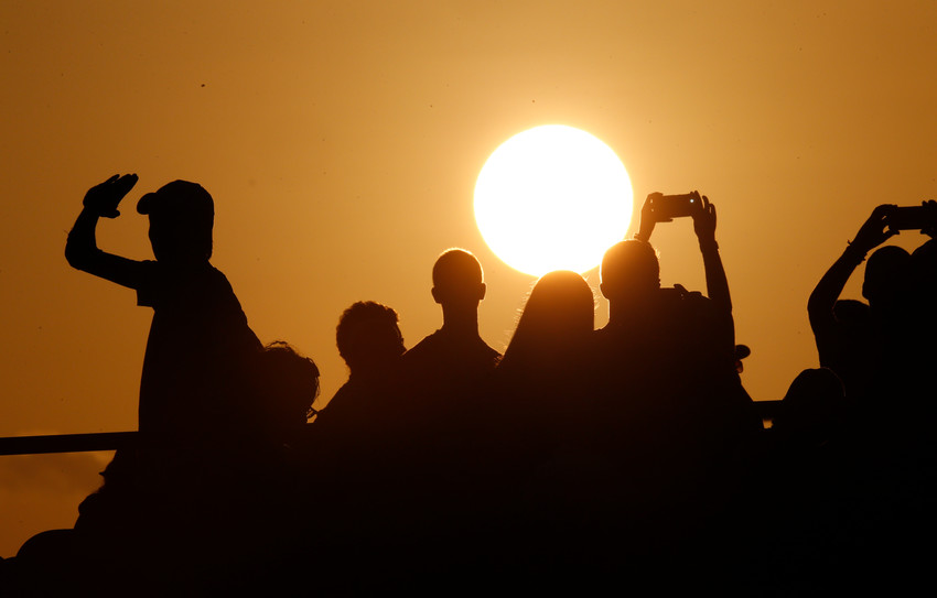The setting sun is seen during World Youth Day as young people wait for Pope Francis' arrival at a prayer vigil at St. John Paul II Field in Panama City Jan. 26, 2019.
