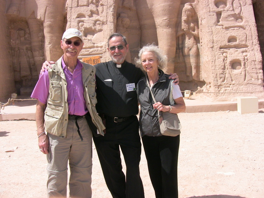 In this 2010 file photo, Thomas and Joan Rillo of St. Charles Borromeo Parish in Bloomington, Ind., pose with Benedictine Brother Maurus Zoeller of Saint Meinrad Archabbey in St. Meinrad during a pilgrimage the monk led to visit Old Testament sites in Egypt. Joan was diagnosed with Alzheimer's disease that same year.