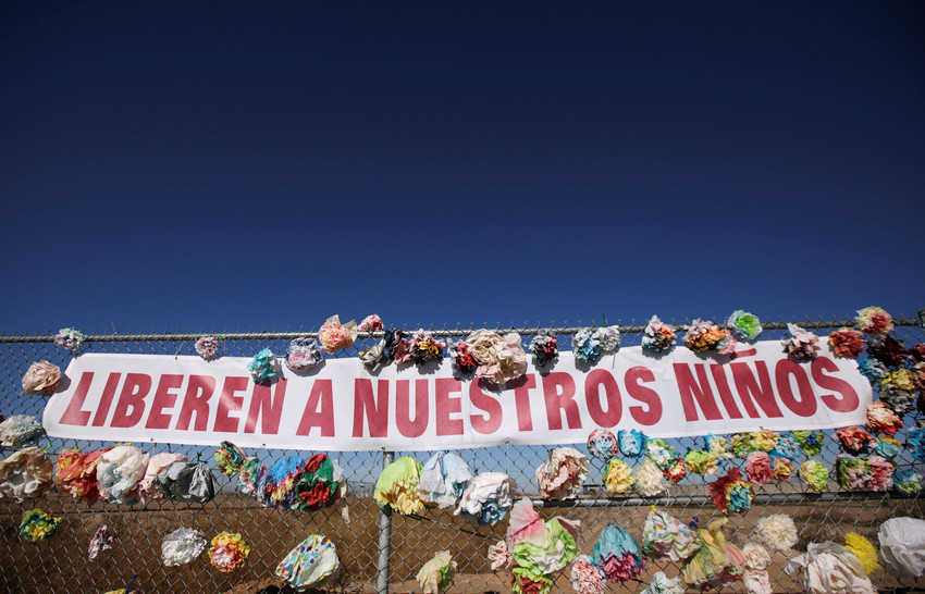 "A banner placed by activists reading ""Let our children go"" hangs from a border fence in Tornillo, Texas. The Catholic Legal Immigration Network, the Southern Poverty Law Center and other organizations have joined in a class-action lawsuit filed on behalf of the more than 10,000 children currently held by the Trump administration in detention centers across the country."