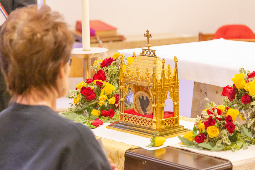 A woman pauses to venerate the incorrupt heart of St. John Vianney, patron saint of parish priests, during a Day of Prayer for Vocations on March 16 in the Cathedral of St. Joseph in Jefferson City. The Knights of Columbus Supreme Council is sponsoring a series of prayer services throughout the country in order to invoke the saint's intercession before God's throne in heaven and to help promote a culture of vocations in Catholic households.