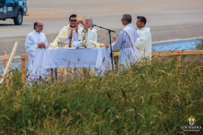 Bishop Mark Seitz Celebrating Mass along the Rio Grande  River that separates the US from Mexico.