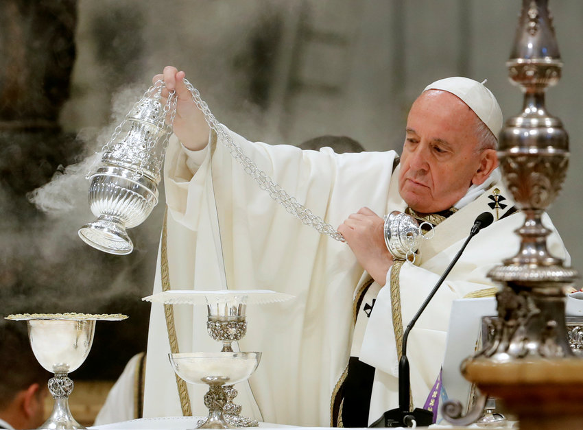 Pope Francis spreads incense as he celebrates Mass on Holy Thursday in St. Peter's Basilica at the Vatican April 18, 2019.