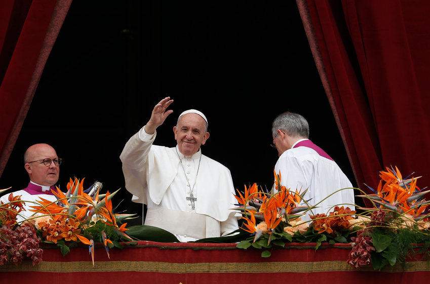"Pope Francis greets the crowd after delivering his Easter message and blessing ""urbi et orbi"" (to the city and the world) from the central balcony of St. Peter's Basilica at the Vatican April 21, 2019."