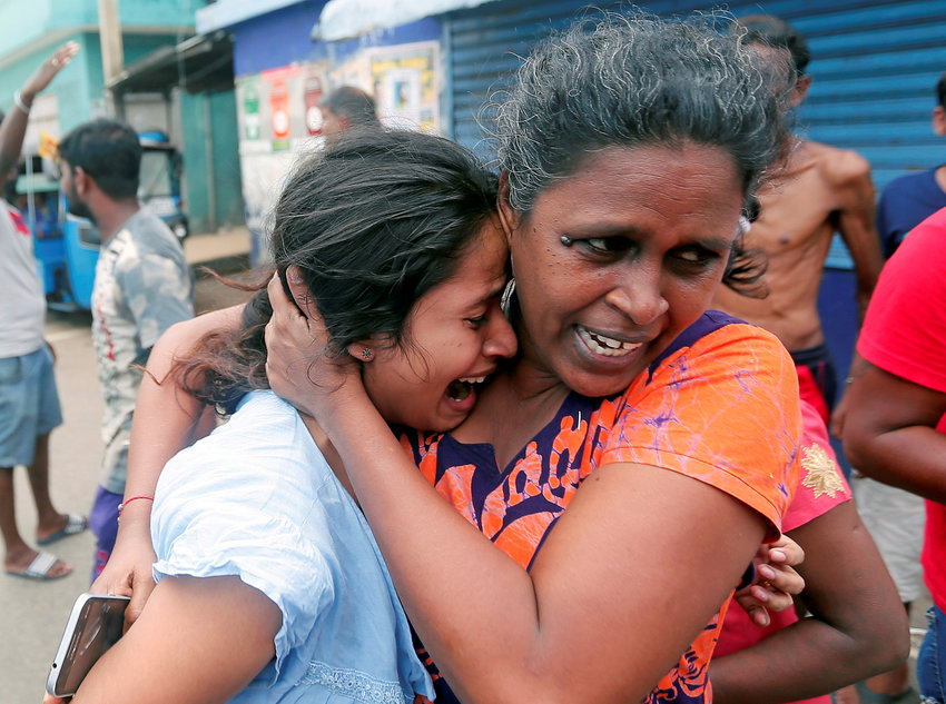 People in Colombo, Sri Lanka, react April 22, 2019, as military attend a suspected van containing explosives. Sri Lankan officials reported 290 confirmed deaths from the eight blasts at churches and hotels in three cities the previous day.