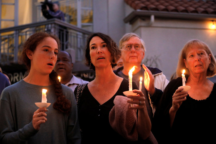 "A candlelight vigil is held April 27, 2019, at Rancho Bernardo Community Presbyterian Church for victims of a shooting incident at the Congregation Chabad synagogue in Poway, Calif., near San Diego. In response to the shooting, Cardinal Daniel N. DiNardo of Galveston-Houston and president of the U.S. Conference of Catholic Bishops, said in an April 28 statement: ""Our country should be better than this; our world should be beyond such acts of hatred and anti-Semitism."" (CNS photo/John Gastaldo, Reuters) See story to come."