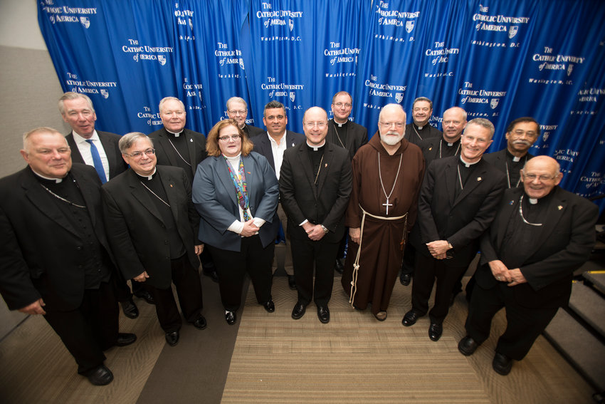 Abuse survivors Teresa Pitt Green, and Luis Torres Jr., center, pose May 1, 2019, with John Garvey, president of The Catholic University of America, back left, and U.S. prelates, at the university in Washington, D.C.