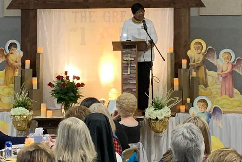 """Jeanne Livers speaks to about 200 women during St. Stanislaus parish's third annual Ecumenical Women's Lenten Retreat in Wardsville. Five women gave presentations on the theme, """"The Great 'I Am': Embracing the Power of God in Our Lives."""""""