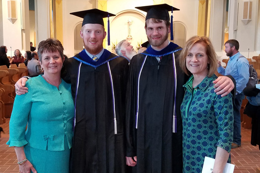 Christopher Hoffmann from Sedalia and Ryan Bax from Jefferson City join their mothers, Linda Hoffmann and Kimmie Bax, in the Basilica of the Immaculate Conception at Conception Abbey on May 11. Both men, seminarians for the Jefferson City diocese, had just graduated from Conception Seminary College. Father Christopher Aubuchon, director of the diocesan Vocations Office, attended the Mass.