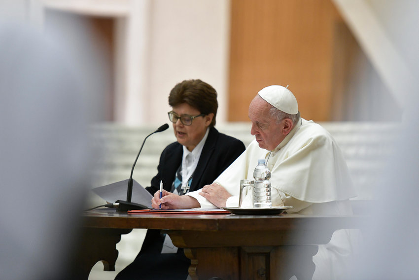 Sister Carmen Sammut, superior general of the Missionary Sisters of Our Lady of Africa and the outgoing president of the International Union of Superiors General, gives her address alongside Pope Francis during a meeting of the organization at the Vatican May 10, 2019, at the Vatican. Sister Carmen and other members were in Rome for the plenary assembly of the International Union of Superiors General, which represents more than 450,000 women religious in more than 100 countries.