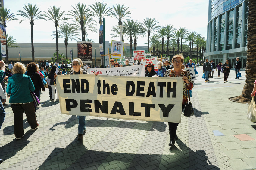 "Demonstrators march through a courtyard to protest the death penalty during a rally organized by ""Catholics Against the Death Penalty-Southern California"" in Anaheim Feb. 25, 2017. On May 30, 2019, New Hampshire became the 21st state to ban capital after lawmakers garnered enough votes to override Gov. Chris Sununu's veto of a bill to repeal the death penalty in the state."