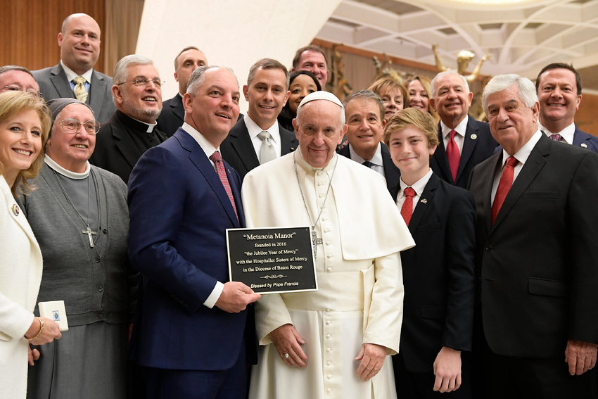 Pope Francis poses for a photo with Louisiana Gov. John Bel Edwards and his delegation during the Pope's general audience at the Vatican Jan. 18, 2017. Edwards, a Catholic, said he will sign into law a measure that makes nearly all abortions illegal in the state once the fetal heartbeat is detected, which could be as early as six weeks.