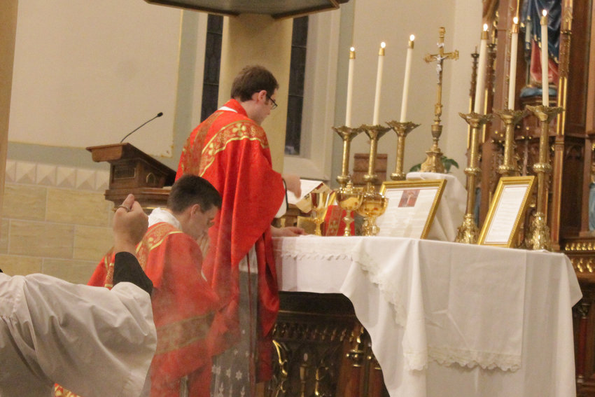 Father Dylan Schrader offers Mass in Latin in the Extraordinary Form last year on the Feast of the Exultation of the Cross, in St. Peter Church in Jefferson City.